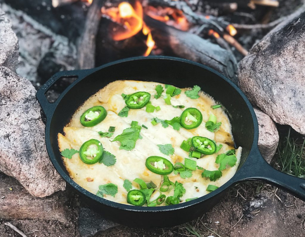 Campfire enchiladas in a dutch oven! The perfect camping recipe.