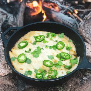Campfire enchiladas in a dutch oven! The perfect camping recipe.
